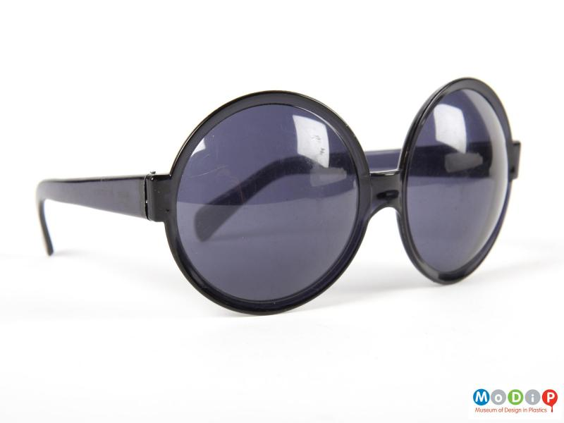 Front view of a pair of sunglasses showing the round lenses.