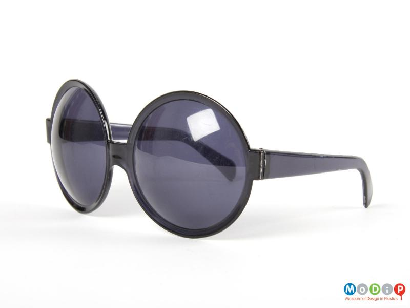 Side view of a pair of sunglasses showing the convex nature of the lenses.