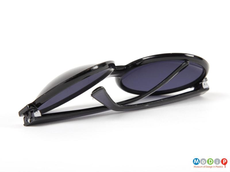 Rear view of a pair of sunglasses showing the arms folded.