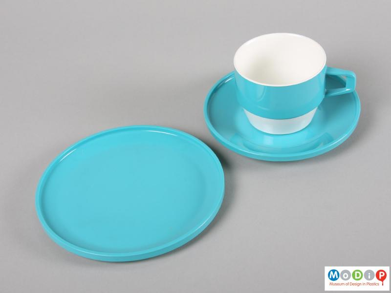 Top view of a set of tableware showing a cup, saucer, and plate.