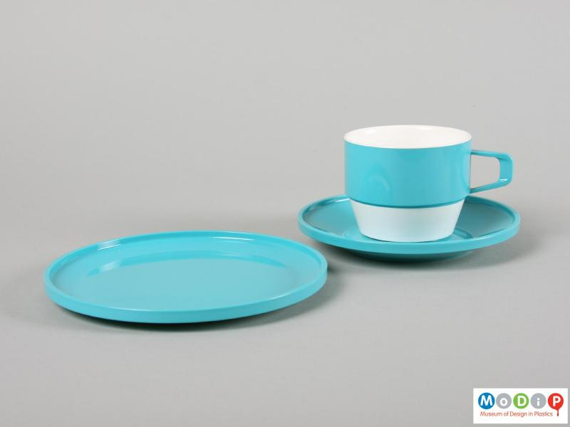 Side view of a set of tableware showing a cup, saucer, and plate.