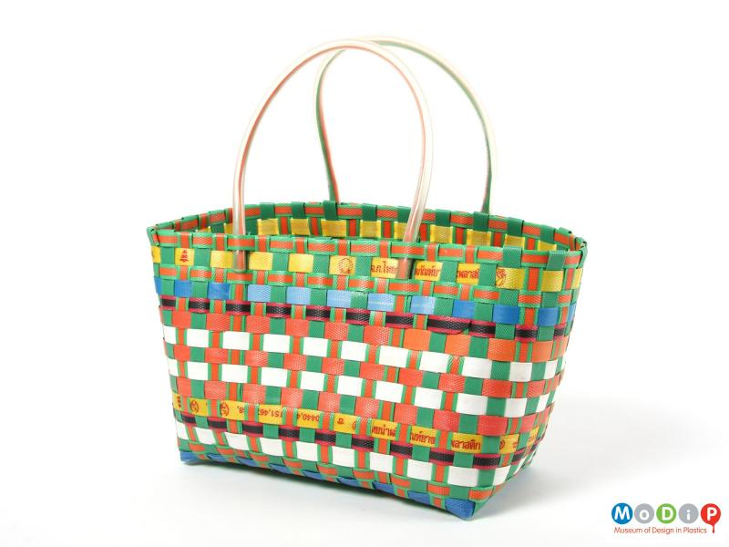Side view of a basket showing the handles made of tubing.