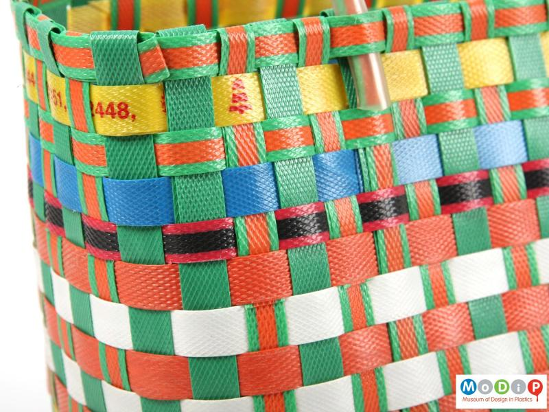 Close view of a basket showing the weave of the tape.