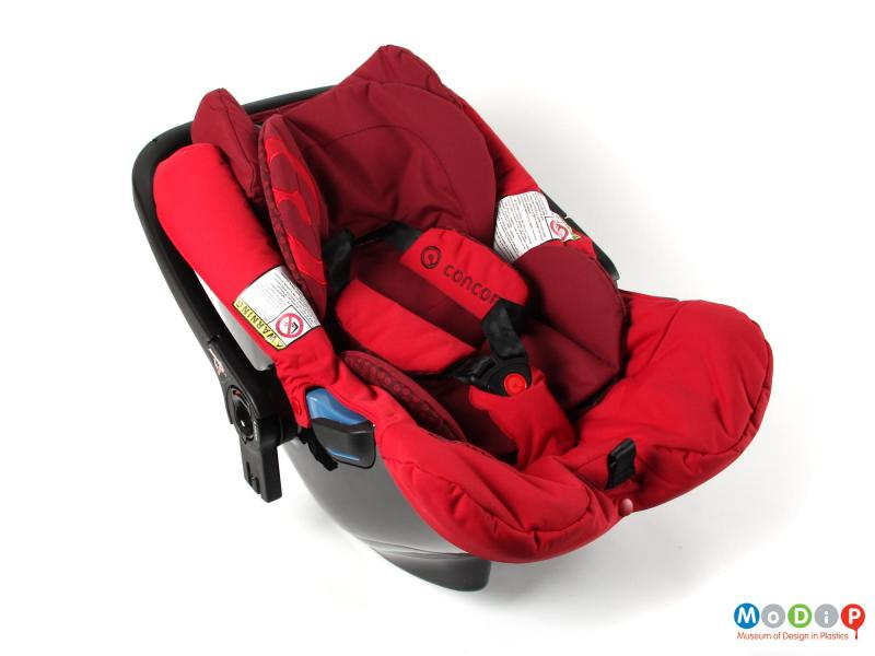 Top view of a car seat showing the padding and safety straps.