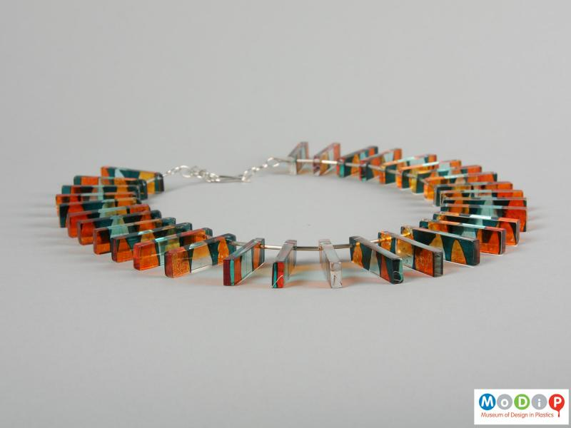 Side view of a necklace showing the rectangular sections.