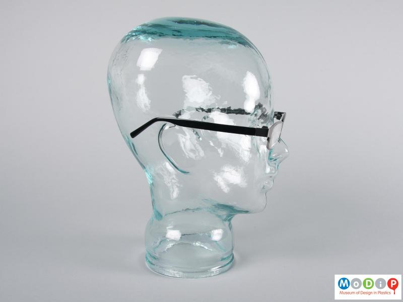 Side view of a pair of glasses showing the arm.