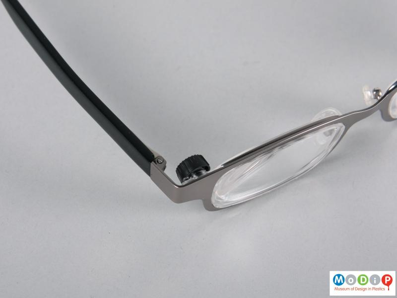 Close view of a pair of glasses showing the lens winder.
