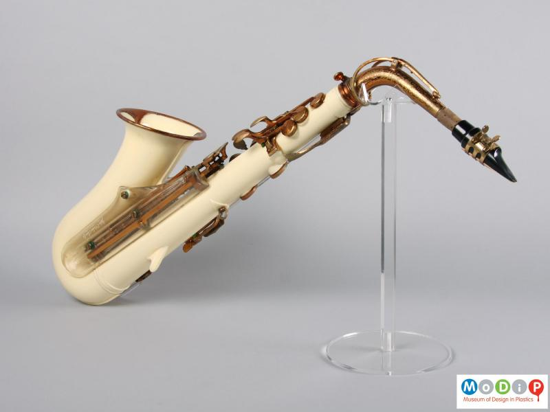 Side view of a saxophone showing the cream coloured body.