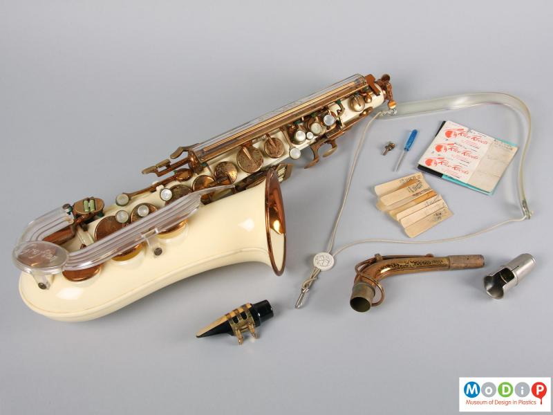 Side view of a saxophone showing the separate parts.