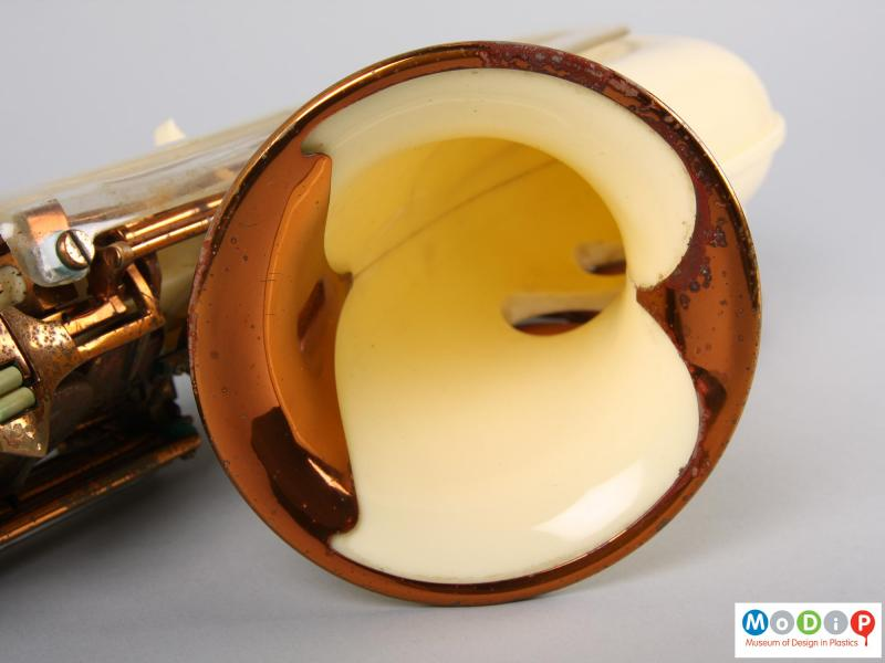 Close view of a saxophone showing the inside of the horn.
