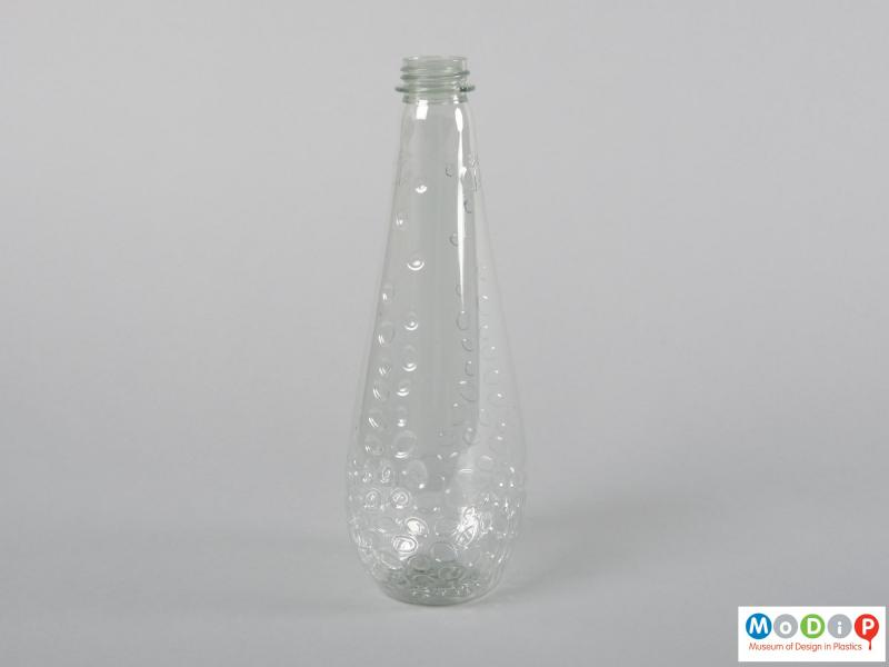 Side view of a bottle showing the shallow depth of the body.