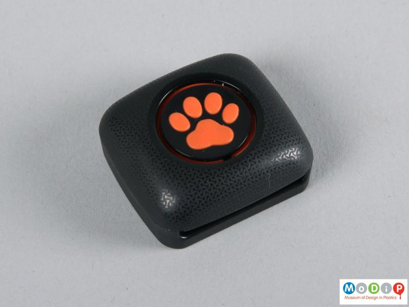 Top view of a tracker showing the paw print logo.