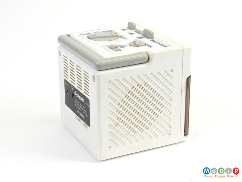 Side view of a radio cassette player showing the speaker grill.