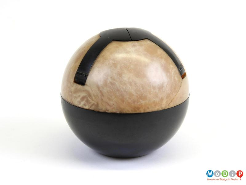 Side view of an ashtray showing the spherical shape.