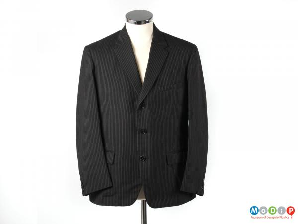 Front view of a jacket from a suit showing the three single buttons.