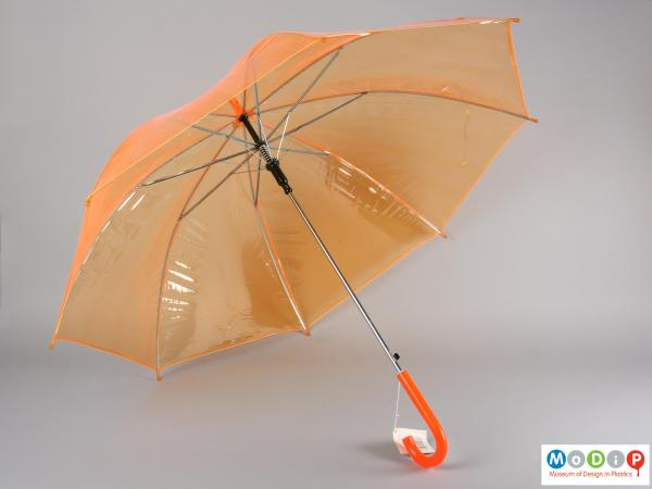 Underside view of an umbrella showing showing the metal mechanism.