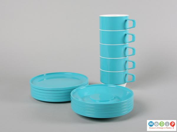 Side view of a set of tableware showing the cups, saucers and plates.