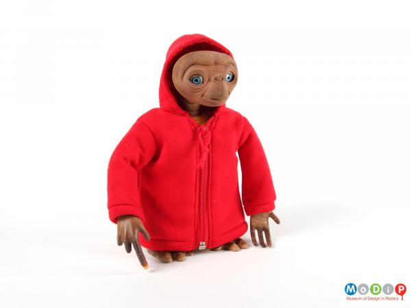 Front view of a doll showing the red hooded jacket.