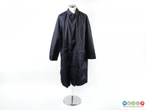 Front view of a rain coat showing the button fastening.