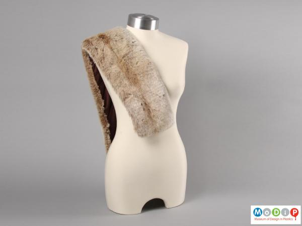 Front view of a synthetic fur scarf showing the scarf draped over one shoulder of a mannequin.