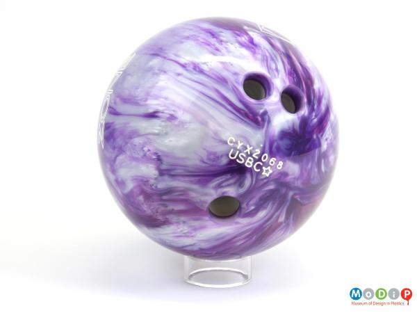 Side view of a bowling ball showing the drill finger holes.