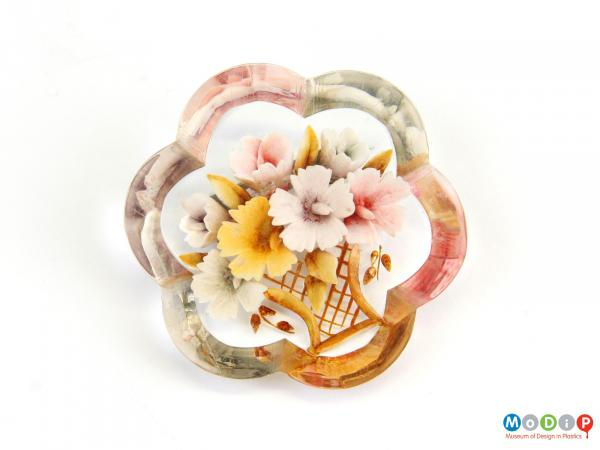 Front view of a brooch showing the floral design.