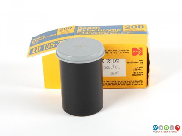 Side view of film packaging showing the canister and the box.