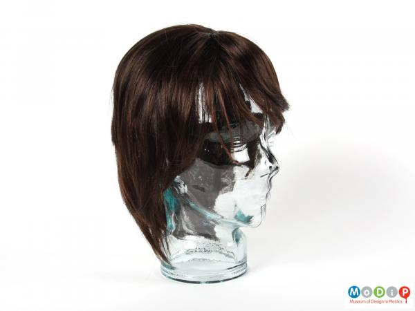 Side view of a wig showing the style and colour.