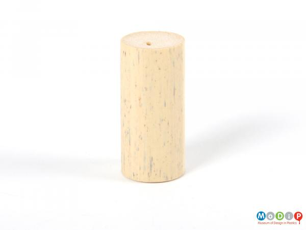 Side view of a cork showing the straight edges and nature-effect colouring.