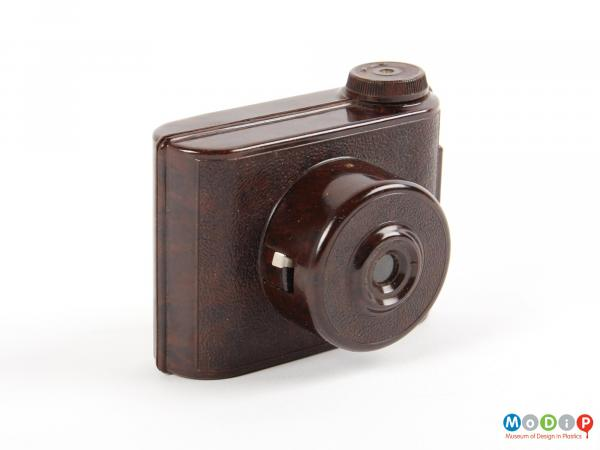 Side view of a camera showing the protruding lens.