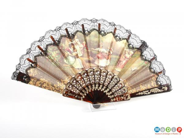 Front view of a hand fan showing it open.