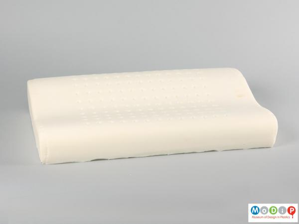 Side view of a pillow showing the contoured shaping.