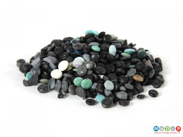 Side view of a pile of pellets showing the mainly black sample.