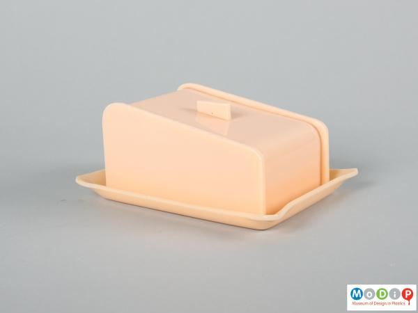 Side view of a butter dish showing the straight sides.
