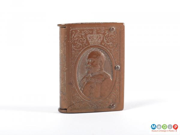 Front view of a vesta case showing the moulded portrait image of King Edward VII.