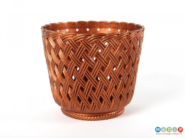 Side view of a plant pot holder showing the basket weave moulded patterning.