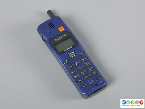 Front view of a mobile phone showing the blue front cover.