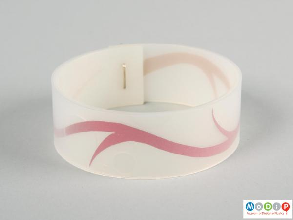 Side view of a bangle showing the encapsulated red strip.