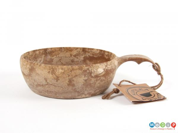 Side view of a bowl showing the sales tag.