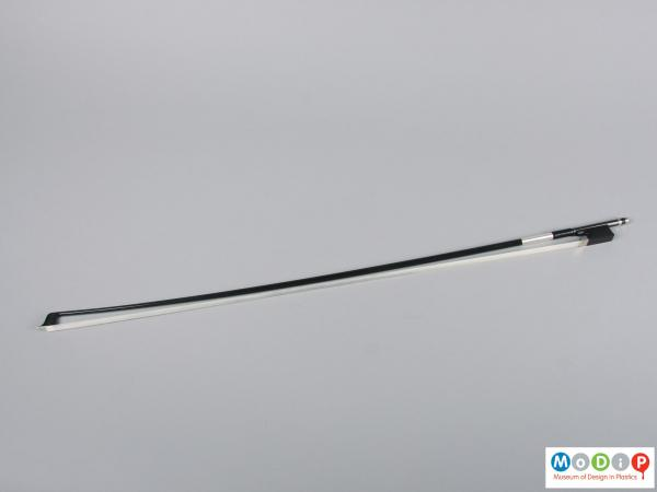 Side view of a violin bow showing the full length.