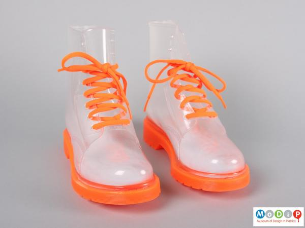 Front  view of a pair of boots showing the orange laces.