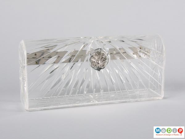 Front view of a clutch bag showing the cut glass style design.