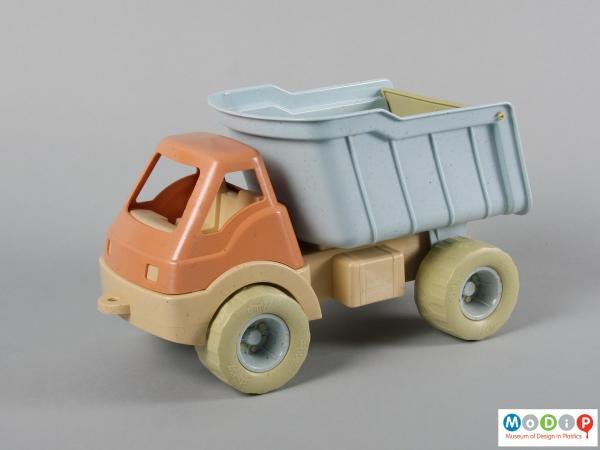 Side view of a toy truck showing the pale colours.