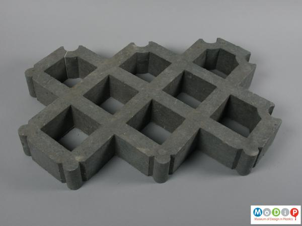 Top view of a paver showing interlocking grid pattern.