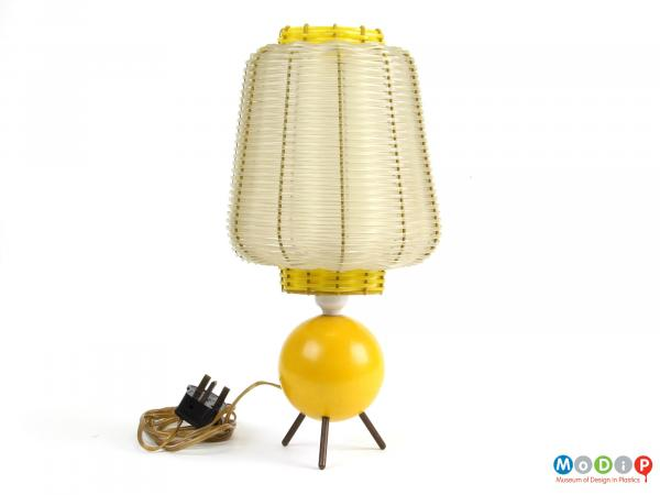 Side view of a lamp showing the three small legs on the spherical base.