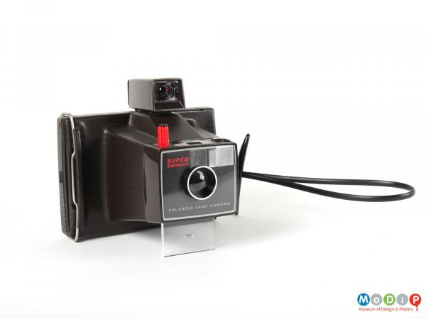 Side view of a Polaroid camera showing the lens housing and flash unit.
