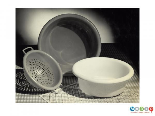 Scanned image showing 2 washing up bowls and a colander.