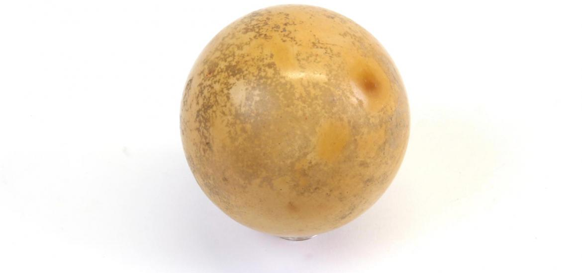 Side view of a ball showing the well used surface.